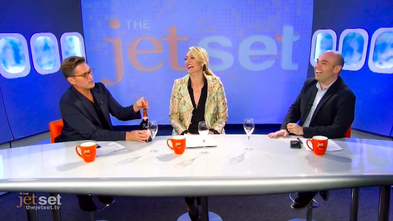 The hosts of The Jet Set on the set of the show