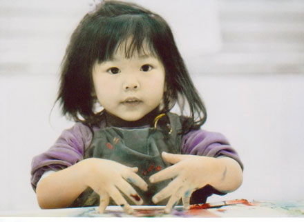 Photo of a Little Girl Finger Painting