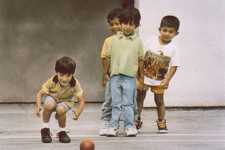 Photo of Four Little Boys Playing Kick Ball